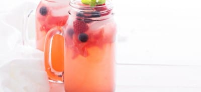 Watermelon lemonade with blueberries and ice cubes, watermelon stars in mason jars