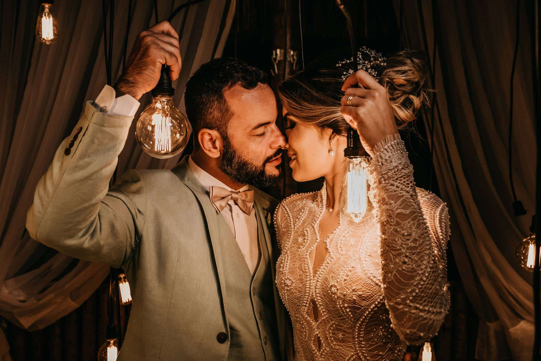 man and woman holding lights while kissing