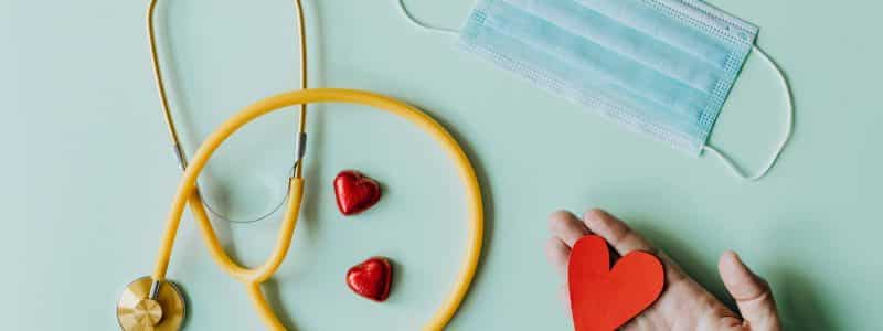 blog medical stethoscope and mask composed with red foiled chocolate hearts