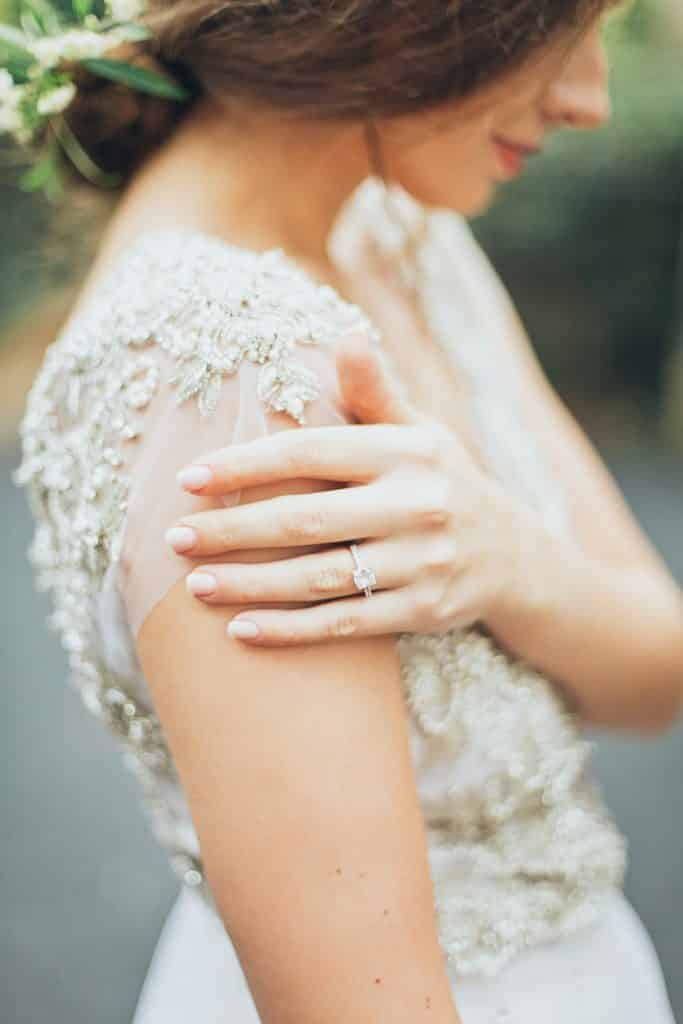 selective focus photography of bride holding right shoulder