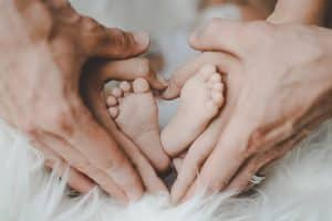 person holding baby s feet