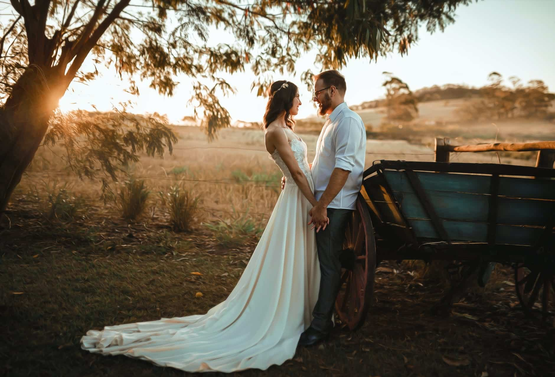 man and woman standing beside carriage