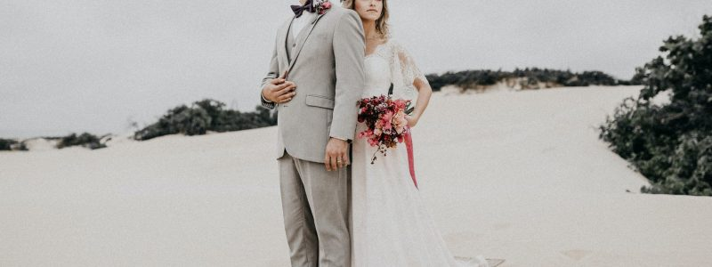 photo of woman holding bouquet