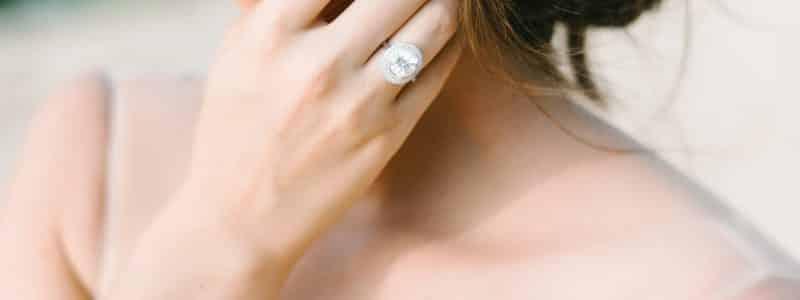 woman wearing diamond ring