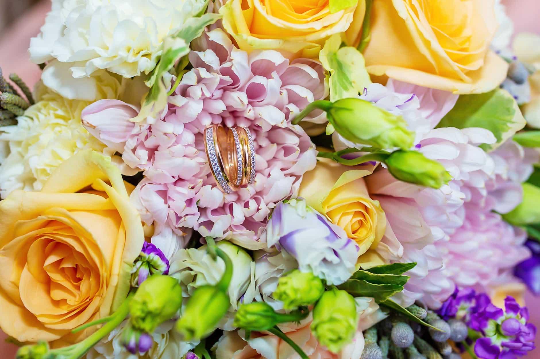 elegant wedding bouquet with golden rings