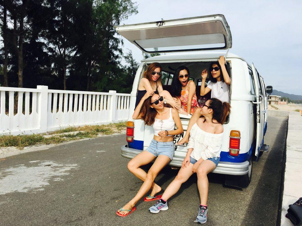 photo of five women sitting in back of van