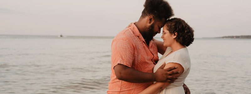 man and woman near sea