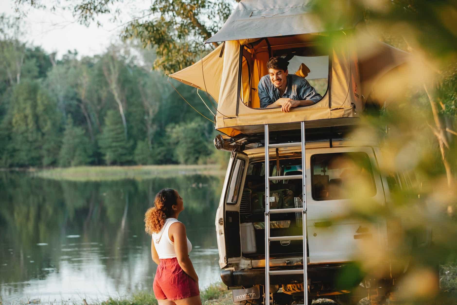 couple enjoying camping together on lakeside
