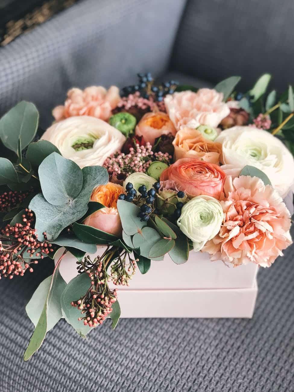 white orange and green floral bouquet decor