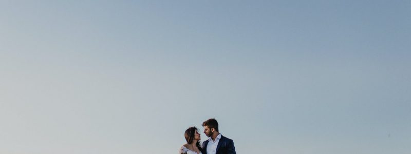 photo of couple standing near each other
