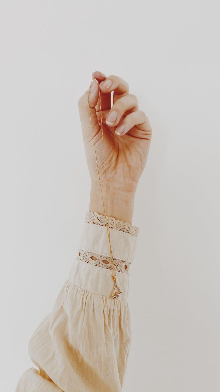 person wearing beige lace dress