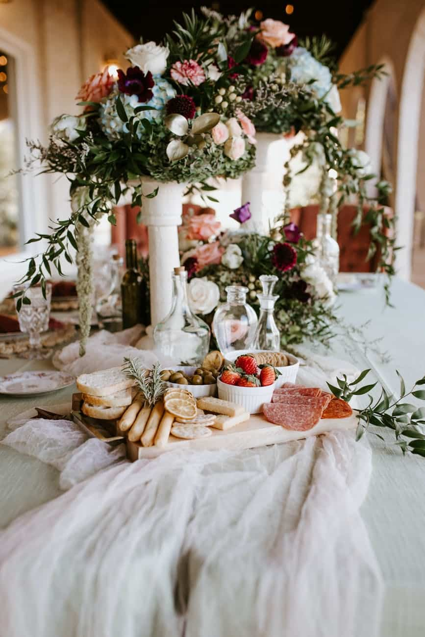 elegant wedding table with bouquets and food