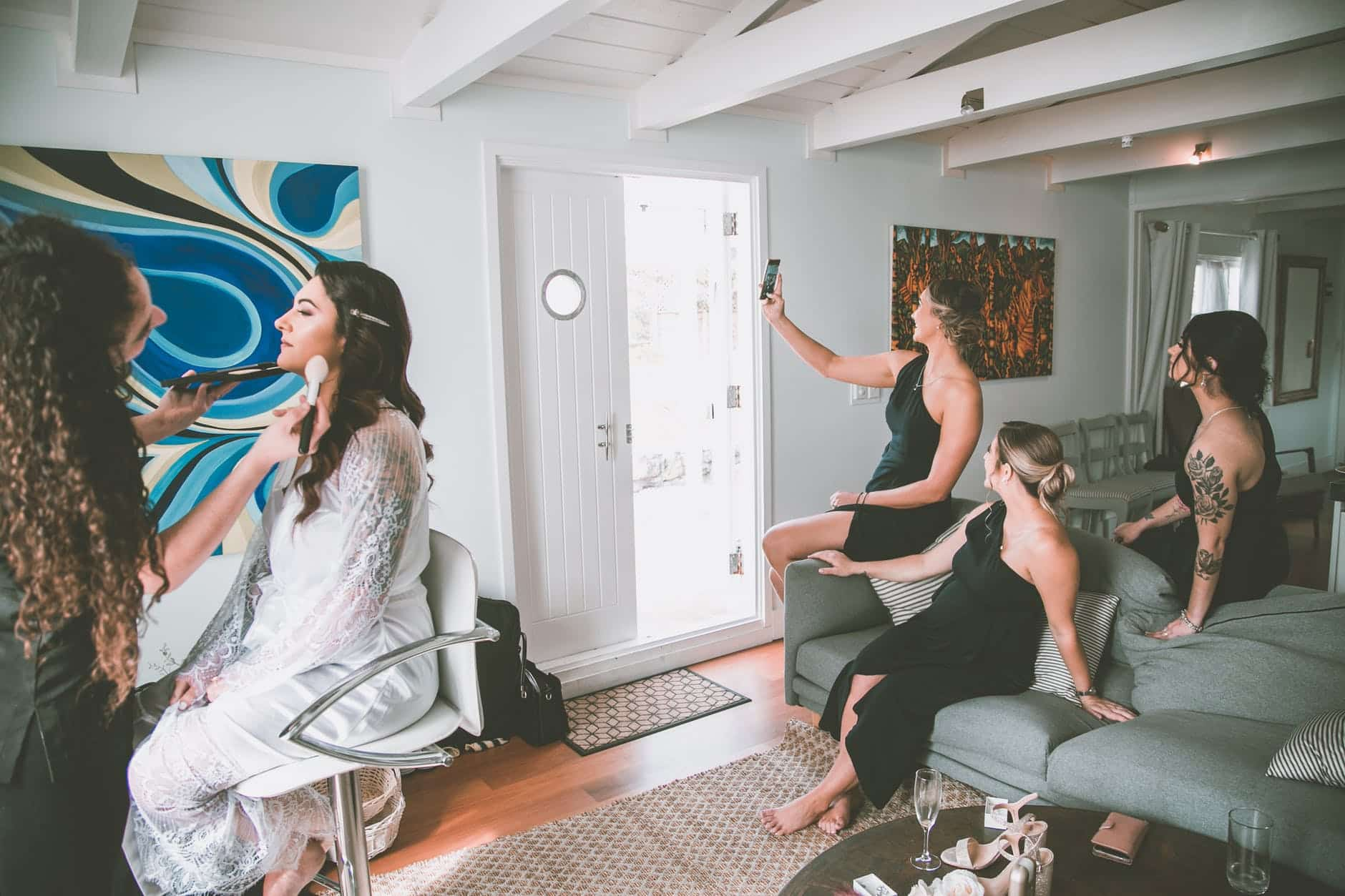 bridesmaids taking selfie during wedding preparations