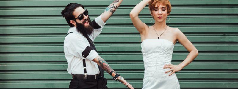 photo of couple posing near roller shutter