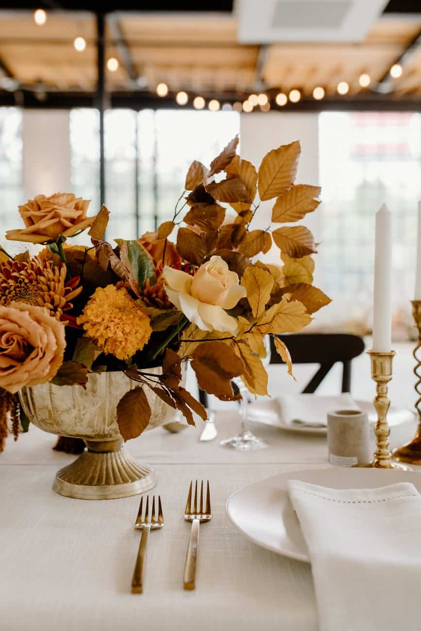 banquet table with elegant flowers and dishware