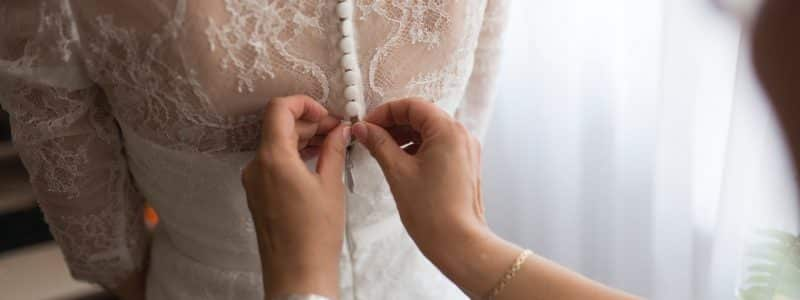 person fixing dress on girl