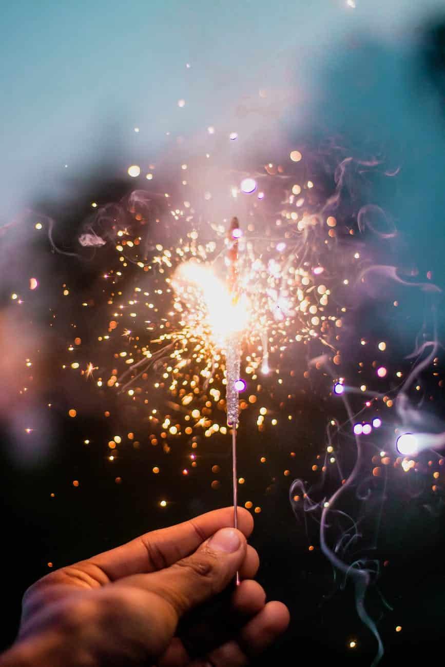 crop man with burning sparkler