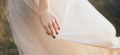 woman wearing white dress with black manicure