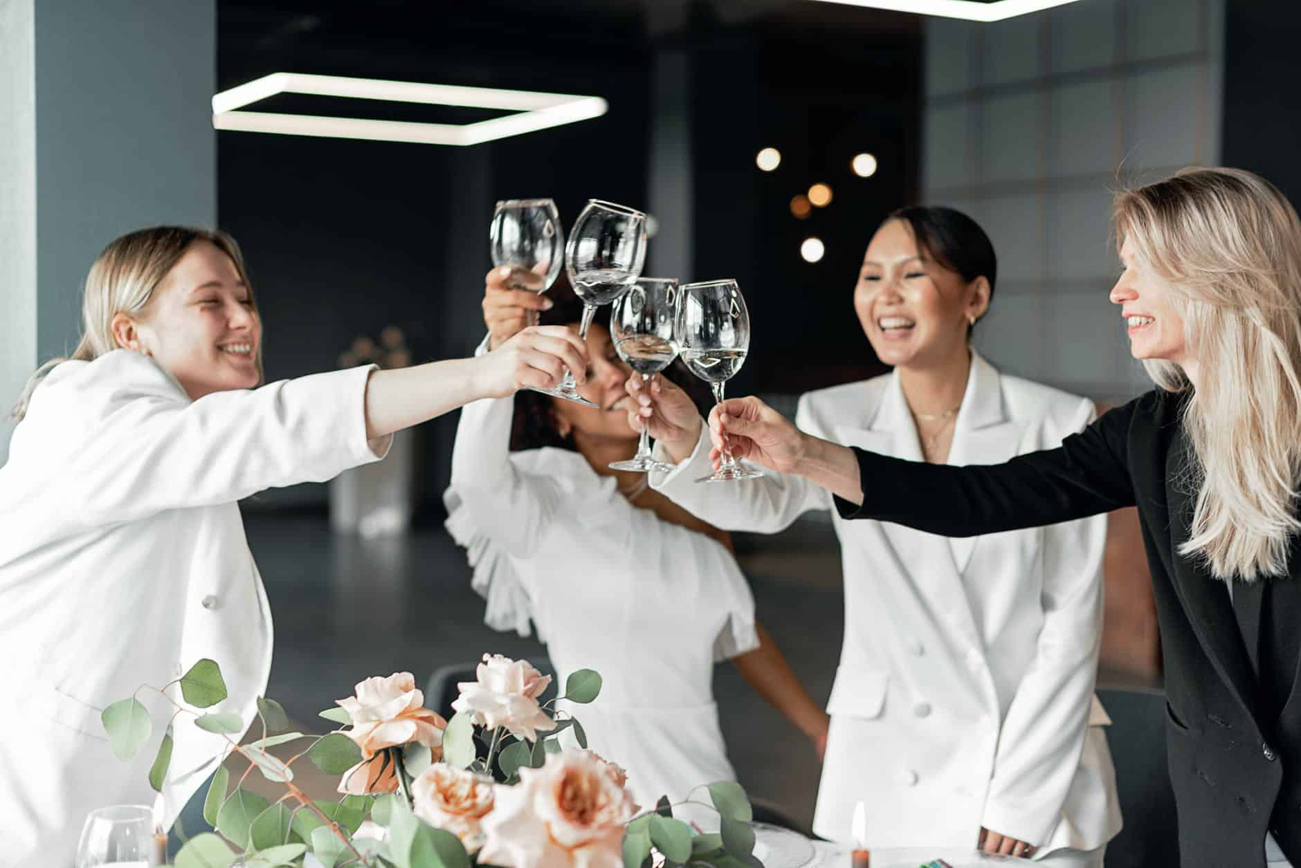 women clinking wine glasses